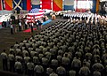US Navy 060401-N-7945K-060 Amphibious assault ship USS Nassau (LHA 4) crew members stand by as Capt. John E. Roberti relieves Capt. Michael W. Brannon as commanding officer during a change of command ceremony.jpg