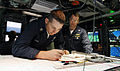 US Navy 060825-N-7441H-013 Petty 1st class Craig Herb, left, plots a course as Lt. David Leathers, right, looks on in the control room aboard the Virginia-class attack submarine USS Texas (SSN 775).jpg