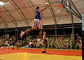 US Navy 061208-N-1328C-530 Elgrace Wilborn, member of the Harlem Globetrotters, dunks the basketball during his performance at Camp Lemonier, home of the Combined Joint Task Force - Horn of Africa (CJTF-HOA) command.jpg
