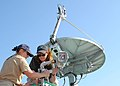 US Navy 070227-N-6020F-013 National Oceanic and Atmospheric Administration (NOAA) Corps Officer Nicola Samuelson and Mary Nichols install a video camera to monitor the positioning of Argus, a tow sled used by the Institute For.jpg