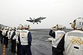 US Navy 070327-N-4009P-246 On the flight deck of the Nimitz-Class aircraft carrier USS Ronald Reagan (CVN 76) a group of distinguished visitors from the Republic of Korea watch as an F-A-18C Hornet prepares for a landing.jpg