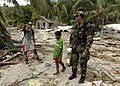 US Navy 070416-N-4790M-254 Lt. Cmdr. Karlwin Matthews, assigned to Navy Medical Corps, stops to talk with a villager about a plan to build a fresh water rain catcher in Gizo.jpg