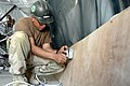 US Navy 070426-N-4928M-037 Construction Mechanic 3rd Class Andrew Clark, a Navy Reservist from Milwaukee, Wi., fixes the electrical wiring in a 1st Light Armored Reconnaissance Battalion housing tent.jpg