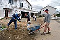 US Navy 070616-N-3390M-001 Sailors assigned to guided-missile destroyer USS Shoup (DDG 86) volunteer to help the less fortunate during a Housing Hope construction project.jpg