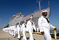 US Navy 070926-N-8907D-092 Sailors disembark from amphibious transport dock USS Shreveport (LPD 12) for the final time during her decommissioning ceremony at Naval Station Norfolk.jpg