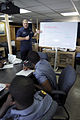 US Navy 080715-G-2443T-001 Cmdr. Robert Hendrickson, executive officer of the U.S. Coast Guard Cutter Dallas (WHEC 716), teaches search-and-rescue procedures to members of the Ghana Navy.jpg