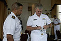 US Navy 080724-N-8273J-103 Chief of Naval Operations (CNO) Adm. Gary Roughead signs ballcaps and coffee mugs during the 36th Annual National Naval Officers Association professional development and training conference.jpg