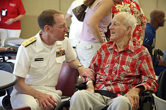 Nursing home care - Rear admiral James A. Symonds talking to a resident of a nursing home in Spokane, Washington, August 2008
