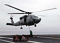 US Navy 080903-N-1161Z-092 Sailors aboard USS George Washington (CVN 73) attach a cargo pendant to an HH-60H Sea Hawk helicopter during a vertical replenishment at sea with USNS Henry J. Kaiser (T-AO 187).jpg