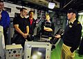 US Navy 081114-N-5758H-222 Lt. Robert Briggs explains the purpose and features of the bridge and pilot house aboard the littoral combat ship USS Freedom (LCS 1) to students from The Ohio State University Navy Reserve Officers T.jpg