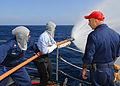 US Navy 081121-N-1082Z-058 Damage Controlman 1st Class Jeffery Parker supervises hose team training.jpg
