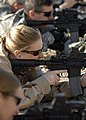 US Navy 081127-N-6278K-150 Intelligence Specialist 1st Class Jessica Norton zeroes in on her M-4 rifle.jpg