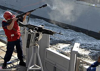 Gunner's mate - Image: US Navy 090107 N 3392P 065 Gunner's Mate Seaman James Clarke fires a shot line to the Military Sealift Command dry cargo ammunition ship USNS Lewis and Clark (T AKE 1)