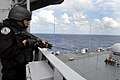 US Navy 090501-N-7478G-227 A member of the Indian Navy simulates a hostage scenario aboard the amphibious command ship USS Blue Ridge (LCC 19) while conducting a visit, board, search, and seizure drill.jpg
