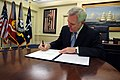 US Navy 090519-N-5549O-007 Ray Mabus signs an affidavit of appointment before his swearing in ceremony as the 75th Secretary of the Navy.jpg