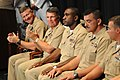 US Navy 090716-N-9818V-230 Master Chief Petty Officer of the Navy (MCPON) Rick West and Rear Adm. Robert Burt, Chief of Navy Chaplains, applauds the 2009 Sailors of the Year during a promotion ceremony at the Navy Memorial.jpg
