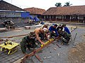 US Navy 090726-N-1831G-015 Builder 2nd Class Ryan Card, second from left, and Builder Constructionman Charles Sprague, third from left help Indonesian Navy engineers prepare a foundation for a building.jpg