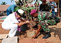 US Navy 090814-N-7095C-145 Rear Adm. Nora Tyson, left, commander of Logistics Group Western Pacific, and an Indonesian Marine Corps officer plant a tree at Pusaka Rakyat primary school.jpg