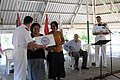 US Navy 090824-N-9689V-005 Mission chaplain Lt. Todd Delaney, presents representatives from the Red Cross and the Kiribati Association of Non-Governmental Organizations, with donations on behalf of Project Handclasp.jpg