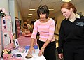 US Navy 091027-N-2541H-001 Nancy Holmes, left, the Naval Medical Center Portsmouth disease manager for Breast, Colorectal and Cervical Health, uses a model of a breast.jpg