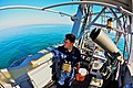 US Navy 100212-N-4585M-001 Electrician's Mate 2nd Class Michael Brockway scans the horizon aboard USS Whirlwind (PC 11).jpg