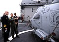 US Navy 100429-N-9917S-004 Lt. Cmdr. Michael Ruckus Ramsey explains unique features of the SH-60B Sea Hawk helicopter to Rear Adm. Anders Grenstad.jpg