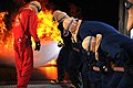 US Navy 100604-N-0569T-131 Midshipmen work together to fight a fire at the Fire Fighting Trainer at Naval Station San Diego.jpg