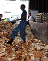 US Navy 100626-N-9634R-134 Seaman Fridah N. Kelley wades through a dumpster of expired bread that will be given to local farmers to use as compost during a community service project at the Feed Nova Scotia food bank.jpg