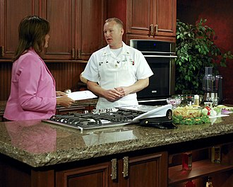 Cooking show - A cook from the US Navy performs on a local TV station.