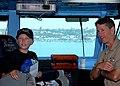 US Navy 100927-N-2811A-156 Linus Phillips talks with Capt. Paul O. Monger during a tour of USS Nimitz (CVN 68).jpg