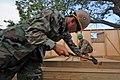 US Navy 110124-N-7589W-070 Sailors build a Southeast Asia Hut.jpg