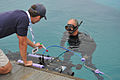 US Navy 110713-N-UN340-006 Space and Naval Warfare Systems Center Pacific diver John Pryor assists University of Florida team member, Patrick Walte.jpg