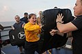 US Navy 111106-N-AX571-374 Ensign Arielle Holland hits the striking bag after being sprayed with oleoresin capsicum during security reaction force.jpg