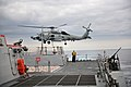 US Navy 111129-N-YZ751-405 A helicopter departs the ship.jpg