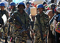 United Nations peacekeepers from Nepal, provide security for Haitian residents waiting in line for rice at a distribution point in Kenscoff, Haiti 100220-N-HX866-005.jpg