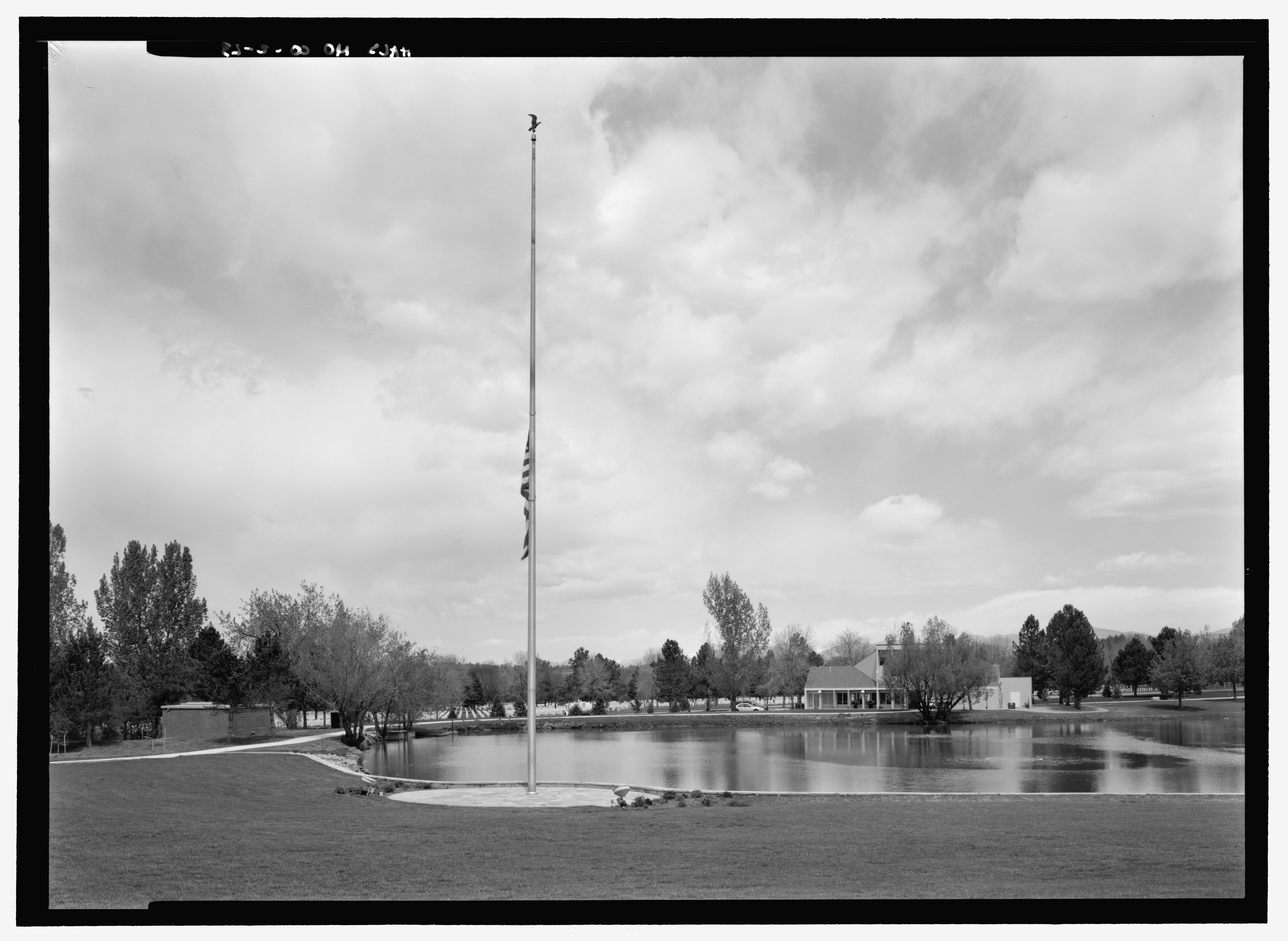 file view of lake and flag pole  with pump house and old