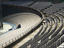 Wooden banked velodrome track with seating behind