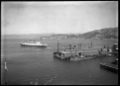 View of Wellington Harbour with the Awatea leaving the wharf ATLIB 327724.png