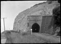 View of the Waitati railway tunnel, through cliffs near Waitati. ATLIB 291057.png