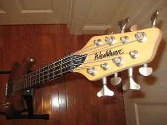Washburn Guitars - Headstock of a Washburn RB2802 eight-string bass.