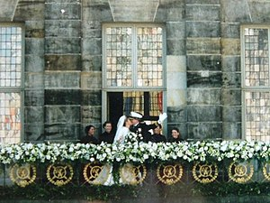 Royal Palace of Amsterdam - The then Prince Willem-Alexander and Princess Máxima kiss on the balcony of the Royal Palace on their wedding day in 2002