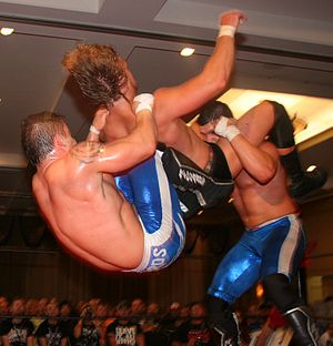 Professional wrestling double-team maneuvers - The American Wolves (Eddie Edwards and Davey Richards) performing a powerbomb-double knee backbreaker combination on Adam Page.