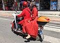 Women riding electric bicycle at Meizhou Town (20201002112610).jpg
