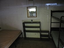 The interior of a room in a Housekeeping Camp lodging unit.