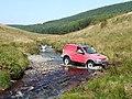 """Off-roader"" fording the Afon Tywi, Ceredigion-Powys - geograph.org.uk - 1571437.jpg"