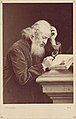 -Bearded Man with Magnifying Glass Examining a Manuscript- MET DP111349.jpg