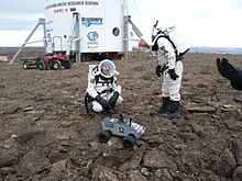 Crew members Joseph Palaia and Vernon Kramer deploy the Omega Envoy prototype lunar rover on July 12, 2009.