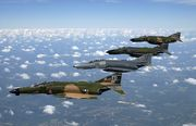 A formation of F-4 Phantom II fighter aircraft fly in formation during a heritage flight demonstration to commemorate the 50th Anniversary of the U.S. Air Force.