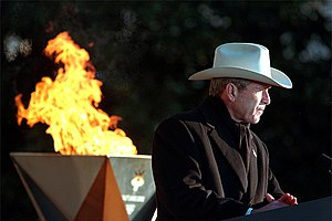 2002 Winter Olympics torch relay - President George W. Bush, with the flame behind, speaks at the White House.