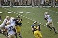 20090912 Theo Riddick runs as Brandon Graham gets loose in the backfield.jpg